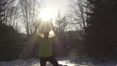 Man holding bid snowball and smiling, steadycam shot, slow motion shot - stock footage