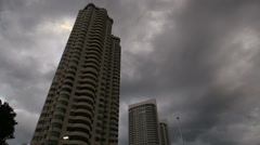 Dark clouds over skyscrapers Stock Footage