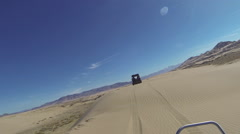 San Dune riding crest in desert sun recreation HD 340 Stock Footage