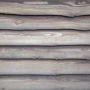 wheathered planks on old barn - stock photo