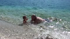 Granddad with grandson in the sea Stock Footage