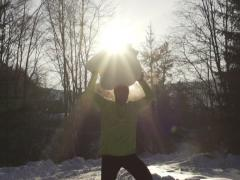 Happy man holding bid snowball, steadycam shot, slow motion shot at 240fps Stock Footage