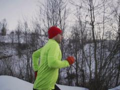 Man jogging alone on wintry day, steadycam shot, slow motion shot at 240fps Stock Footage