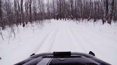 Snowmobile rides in the winter woods. Stock Footage