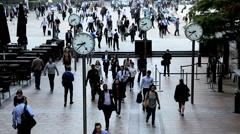 London UK Canary Wharf city commuters clocks people business Stock Footage