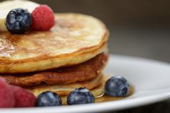 Stock Photo of Classic pancakes with butter berrys and maple syrup
