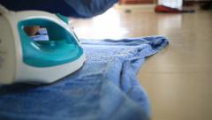 Maid use iron press clothes - stock footage