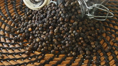 Dry black pepper rotation, close up peppercorn in the glass jar, able to loop Stock Footage