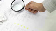 Bookkeeping with Magnifying Glass - stock footage