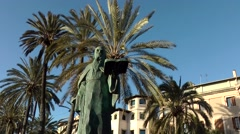 Spain Palma de Mallorca 055 statue of Ramon Llull with palm trees in background Stock Footage