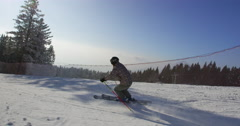 Beautiful Sun Flared Slow Motion 4k Of Skier Carving Down The Ski Slope Stock Footage