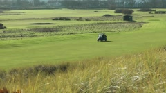 Golf buggy on links golf course Stock Footage