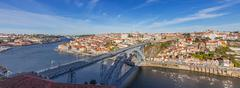 View of the iconic Dom Luis I bridge crossing the Douro River - stock photo