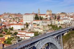 View of Dom Luis I bridge that crosses the Douro River in Porto, Portugal - stock photo