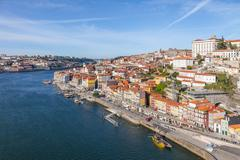 Stock Photo of Colorful buildings of Ribeira District and the Douro River in Porto, Portugal