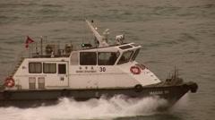 Patrol Boat speeding across Hong Kong Harbor Stock Footage