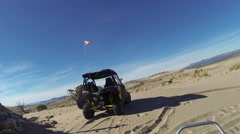 Sand Dunes Can Am 4x4 ATV on desert hill HD 340 Stock Footage