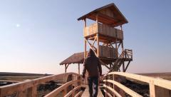 The Wooden Watchtower Man Approach Stock Footage