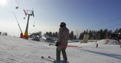 Slow Motion 4K Of Skier Returning To Ski Resort After All Day Of Skiing Stock Footage