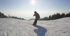 Slow Motion 4k Of Professional Skier Enjoying Last Ride Of Skiing Down The Slope - stock footage