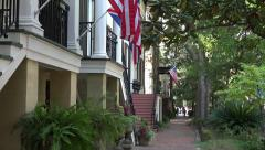 Steps to house with US flags in downtown Savannah, GA, USA Stock Footage
