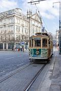The old tram passes by the Aliados Avenue and Liberdade Square Stock Photos