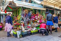 Artificial flowers stand in the interior of the historical Bolhao Market - stock photo