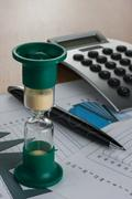Hourglass on the table businessman - stock photo