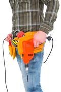 Stock Photo of Smiling manual worker holding drill machine