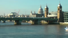 St Pauls Cathedral and Cannon Street station with train and riverboat Stock Footage