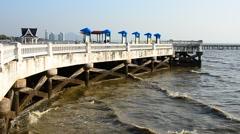 Sea wave with wall construction at Wonnapa beach, Bangsaen, Chonburi, Thailand Stock Footage
