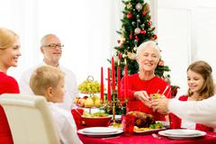 Stock Photo of smiling family having holiday dinner at home