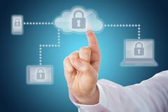 Index Finger Touching Lock Icon In Cloud Network Stock Photos