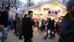 People enjoying the famous Christmas Market in Paris, France. Stock Footage