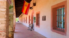 View of the columns and adobe walls of a California Mission. Stock Footage