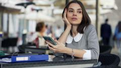 Unhappy businesswoman waiting for someone sitting in cafe in city HD - stock footage