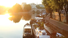 Stock Video Footage of France Paris River Seine IIe de la Citie sunrise boat