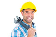 Smiling manual worker holding adjustable spanner - stock photo