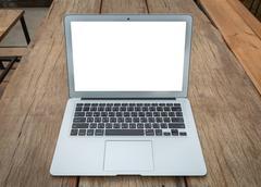 Blank screen laptop computer on wood table Kuvituskuvat