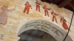 Murals line the adobe walls of a California Mission. - stock footage