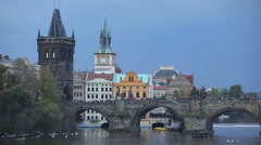 The Old Town Charles bridge tower in Prague in the evening Stock Footage