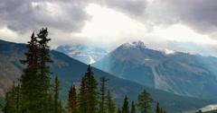 4K Ultra Wide Angle View of Mountain Vista, Rocky Mountains, Smoky Sun Rays Stock Footage