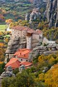 Roussanou Monastery and Meteora Rocks in Greece - stock photo