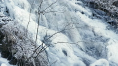 Ice covered waterfall in slow motion. Stock Footage