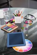 Colour samples and digitizer on desk Stock Photos