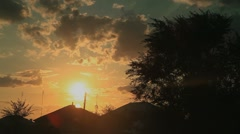 Sunset over the houses - stock footage