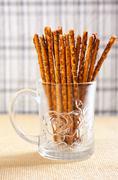 Crunchy sticks with poppy seeds Stock Photos