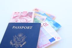 Stock Photo of american passport and multinational currencies