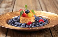 Stock Photo of Custard filled puff pastry shell and fresh blueberries
