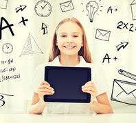 girl with tablet pc at school - stock photo
